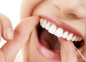 Cepillado e hilo dental